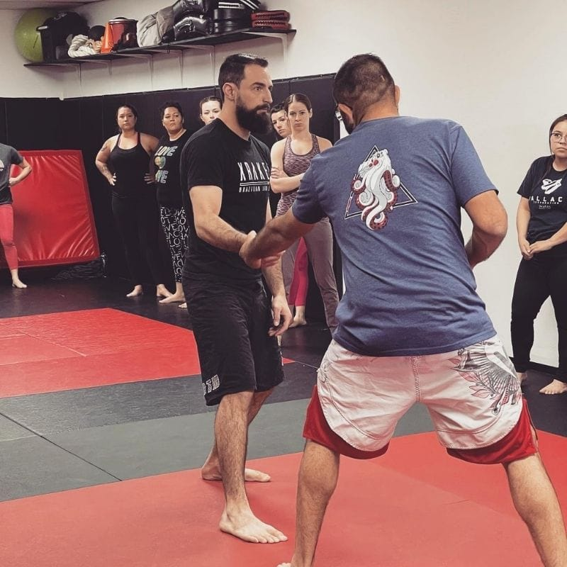 Coach Tyler demonstrating self-defense techniques