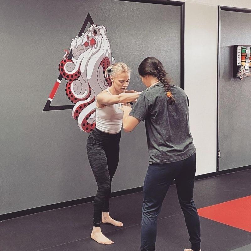 Practicing women's self-defense techniques